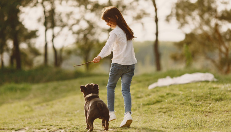 Portrait of a little girl with her beautiful dog